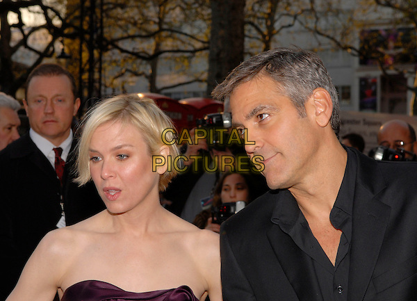 """RENEE ZELLWEGER & GEORGE CLOONEY .Attending the """"Leatherheads"""" European Film Premiere held at the Odeon cinema, Leicester Square London, England, 8th April 2008..portrait headshot funny strapless black.CAP/IA.©Ian Allis/Capital Pictures"""