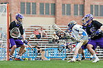 Los Angeles, CA 02/15/14 - Anthony Noren (UCLA #11), Holdon Milner (Washington #16), Garrett Remsen (Washington #15) and Devin McDermott (Washington #25) in action during the Washington versus UCLA  game as part of the 2014 Pac-12 Shootout at UCLA.  UCLA defeated Washington 13-7.