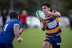 Vaha Fili gets the ball away before Kurt McKenzie can make the tackle. Counties Manukau Premier Club Rugby game between Patumahoe and Ardmore Marist, played at Patumahoe, on Saturday June 07 2014. Patumahoe won the game 23- 3 after being 3 all at halftime  Photo by Richard Spranger