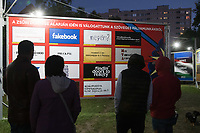 Visitors watch a set of text based billboard plans entered on the contest of the Arc Billboard social issues exhibition in the topic of fake news in Budapest, Hungary on Sept. 24, 2018. ATTILA VOLGYI