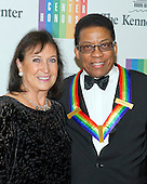2013 Kennedy Center honoree Herbie Hancock and his wife, Gigi, arrive for the formal Artist's Dinner honoring the recipients of the 2014 Kennedy Center Honors hosted by United States Secretary of State John F. Kerry at the U.S. Department of State in Washington, D.C. on Saturday, December 6, 2014. The 2014 honorees are: singer Al Green, actor and filmmaker Tom Hanks, ballerina Patricia McBride, singer-songwriter Sting, and comedienne Lily Tomlin.<br /> Credit: Ron Sachs / Pool via CNP