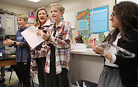 NWA Democrat-Gazette/DAVID GOTTSCHALK Elizabeth Brown (from right), with Walmart Logistics, watches Wednesday, January 10, 2018, as Wesley Marsh, a sixth grade student at Holt Middle School, is recognized by Debbie Hodges, Walmart Logistics, along with his twin brother David as the 2018 Dr. Martin Luther King Jr. Dream Award Winners for Fayetteville Schools. The essay contest is for sixth grade students. Winning essays were selected from the Bentonville, Rogers, Springdale and Fayetteville School Districts. The winning students receive a variety of prizes, a cash donation to their schools and the opportunity to participate in the Dr. Martin Luther King Jr. recognition and celebration event at the Walmart Home Office Monday in Bentonville.