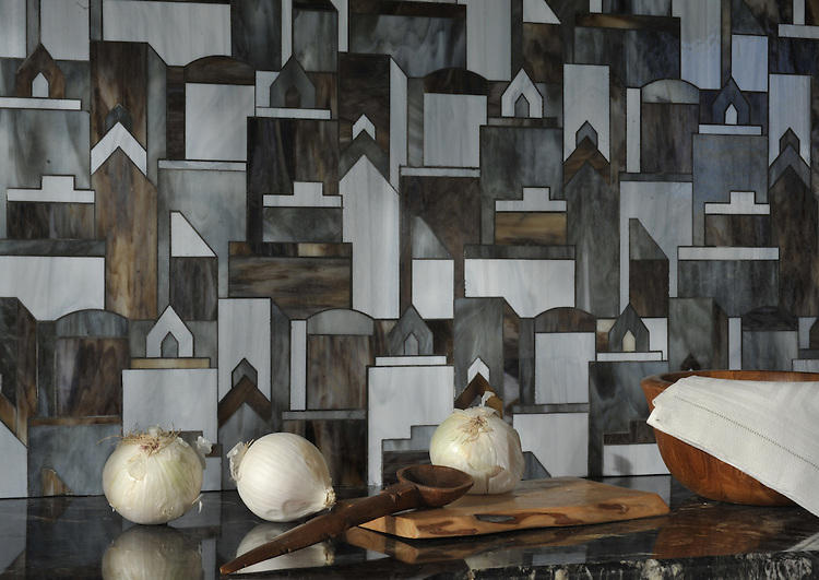 Cityscape, a waterjet glass mosaic shown in Pearl, Lavastone, and Tourmaline, is part of the Erin Adams Collection for New Ravenna.