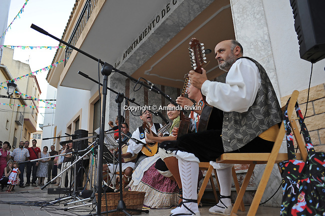 Musicians play during a performance of traditional dances of the Valencian region in the main square during the municipal fiestas in Costur, Spain on August 15, 2009.