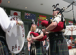 10 June 2006: Soccer fans and locals enjoy market day in Frankfurt before the game. The local Rhine Area Pipe and Drum bagpipe corps entertains the crowd. England played Paraguay at Commerzbank Arena in Frankfurt, Germany in match 3, a Group B first round game, of the 2006 FIFA World Cup.