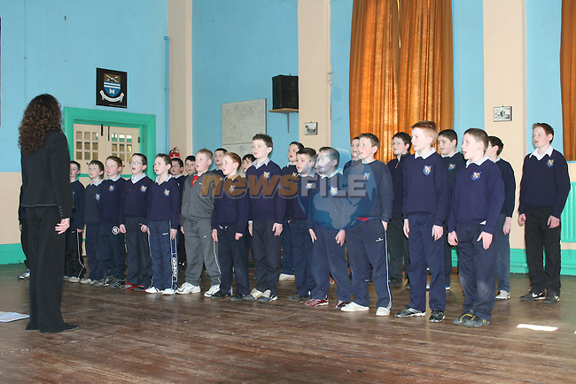 Students from the Monastery National School, Ardee, practising their part for the Path To Peace Concert in the Waterfront Hall, Belfast at 8pm on Friday 16th February.  They are helped here by Sharon Treacy Dunne, Director of Cross Border Orchestra of Ireland (CBOI)..Photo NEWSFILE/Jenny Matthews.(Photo credit should read Jenny Matthews/NEWSFILE)....This Picture has been sent you under the condtions enclosed by:.Newsfile Ltd..The Studio,.Millmount Abbey,.Drogheda,.Co Meath..Ireland..Tel: +353(0)41-9871240.Fax: +353(0)41-9871260.GSM: +353(0)86-2500958.email: pictures@newsfile.ie.www.newsfile.ie.FTP: 193.120.102.198.