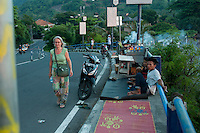 New Year's Eve, and locals set up on the footpath at a good position for watching the sunset . . . pedestrians just have to be flexible.
