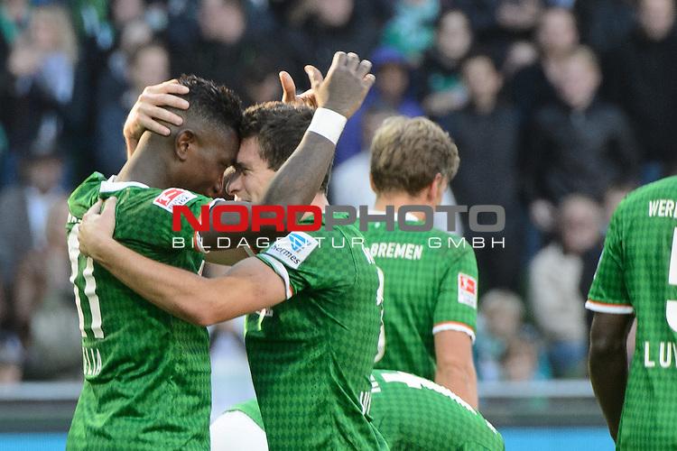 29.09.2013, Weser Stadion, Bremen, GER, 1.FBL, Werder Bremen vs 1. FC Nuernberg, im Bild<br /> Jubel 3 zu 1 <br /> Eljero Elia (Bremen #11) mit Zlatko Junuzovic (Bremen #16)<br /> <br /> <br /> <br /> <br /> Foto &copy; nph / Kokenge