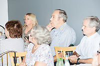 "People listen as Harvard Law professor and Democratic presidential candidate Lawrence Lessig speaks at a meeting of the Salem Democrats at The Colosseum Restaurant in Salem, NH. This campaign event was Lessig's first visit to New Hampshire, though he had not yet raised the $1 million he wanted to raise before officially declaring his candidacy. The following week, Lessig raised the money and declared his candidacy. Lessig is running an unusual campaign, calling himself a ""referendum candidate."" He has said his campaign will focus on a single issue, The Citizen Equality Act, which would reform campaign financing, gerrymandering, and access to voting. Lessig has pledged that, if elected, once the Citizen Equality Act becomes law, he will immediately resign and turn the presidency over to his vice president."