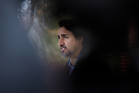 Prime Minister Trudeau speaks with media outside of Rideau Cottage during his ongoing self-isolation. March 28, 2020.