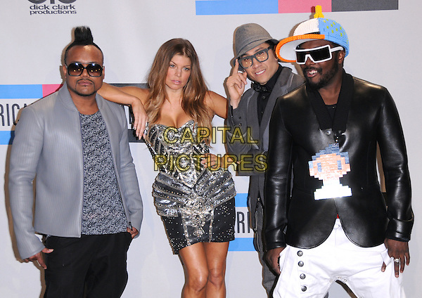 BLACK EYED PEAS - Apl.de.ap, Fergie, Taboo, Will.i.am .at The 2010 American Music  Awards held at Nokia Theatre L.A. Live in Los Angeles, California USA, .November 21st 2010..amas Pressroom   press half length band group grey gray jacket black trousers white silver dress strapless hat sunglasses cap leather Stacy Ferguson .CAP/RKE/DVS.©DVS/RockinExposures/Capital Pictures.