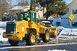 Feb. 9, 2013  Merrick, New York, U.S. - After Blizzard Nemo hits Long Island South Shore communities, Town of Hempstead snow plows clear streets.