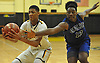 Craig Brown #33 of Uniondale, left, grabs an inbounds pass as Keenan White #13 of Copiague pressures him during a non-league game in the Richard Brown Nassau-Suffolk Challenge at Uniondale High School on Saturday, Jan. 14, 2017.