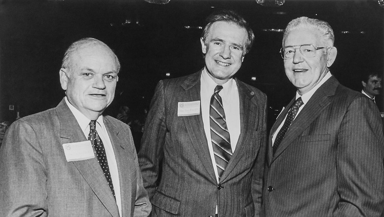 Former Rep. Lucien N. Nedzi, D-Mich., Sen. Donald W. Riegle, D-Mich., and Dr. Robben Wright Fleming, University of Michigan President at University of Michigan Alumni Congressional breakfast in March 1988. (Photo by CQ Roll Call)