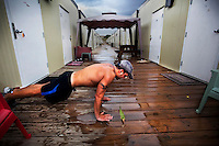A guard does push-ups outside his room in the trailer complex where guards are housed at the American naval base at Guantanamo Bay, where over 600 alleged al Qaeda members have been held indefinitely. Described by the US as 'unlawful enemy combatants', they were captured primarily in Afghanistan during the 'war against terror'.