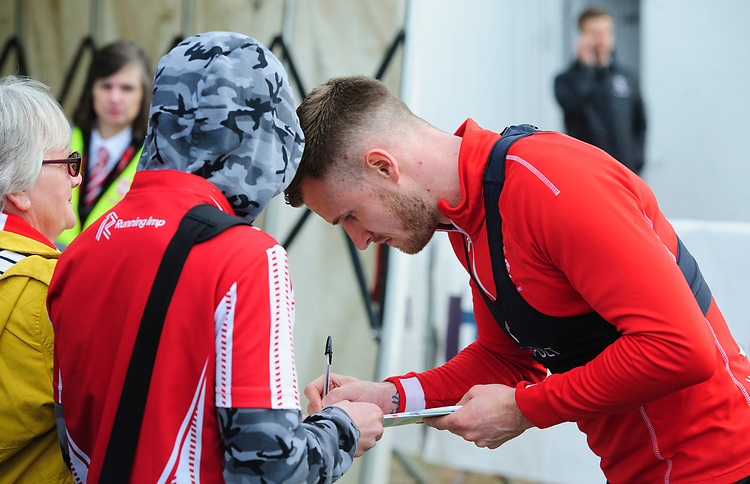 Lincoln City's Michael O'Connor signs an autograph for a fan during the pre-match warm-up<br /> <br /> Photographer Chris Vaughan/CameraSport<br /> <br /> The EFL Sky Bet League Two - Lincoln City v Macclesfield Town - Saturday 30th March 2019 - Sincil Bank - Lincoln<br /> <br /> World Copyright © 2019 CameraSport. All rights reserved. 43 Linden Ave. Countesthorpe. Leicester. England. LE8 5PG - Tel: +44 (0) 116 277 4147 - admin@camerasport.com - www.camerasport.com