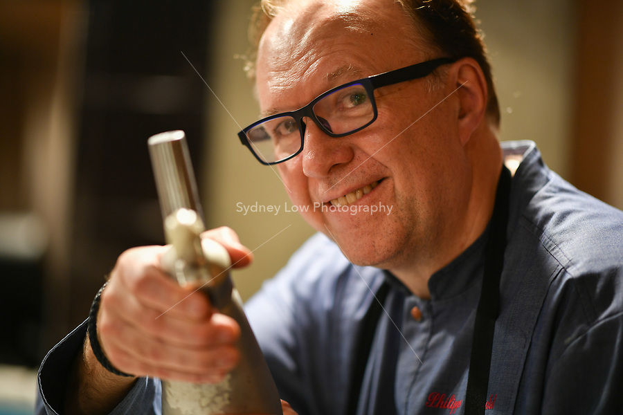 Philippe Mouchel pretends to fire a gas gun during a dinner at Philippe Restaurant in Melbourne, Australia on 12 September 2017. Photo Sydney Low