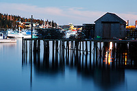 Fishing dock and boats at dusk, Bernard, Tremont, Maine, USA