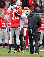 Ohio State Buckeyes head coach Urban Meyer hugs Ohio State Buckeyes quarterback Kenny Guiton (13) during  senior day before the start of their game against Indiana Hoosiers at Ohio Stadium in Columbus, Ohio on November 23, 2013.  (Dispatch photo by Kyle Robertson)