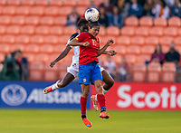 Shirley Cruz #10 of Costa Rica goes up for a header