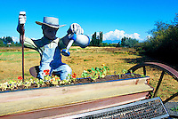 Terra Nova Rural Park, Richmond, BC, British Columbia, Canada - Gardener Sculpture waters Flowers at the Terra Nova Community Garden