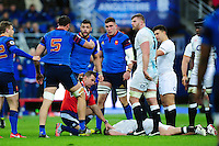 Referee Nigel Owens keeps France players away as Dylan Hartley lies injured. RBS Six Nations match between France and England on March 19, 2016 at the Stade de France in Paris, France. Photo by: Patrick Khachfe / Onside Images