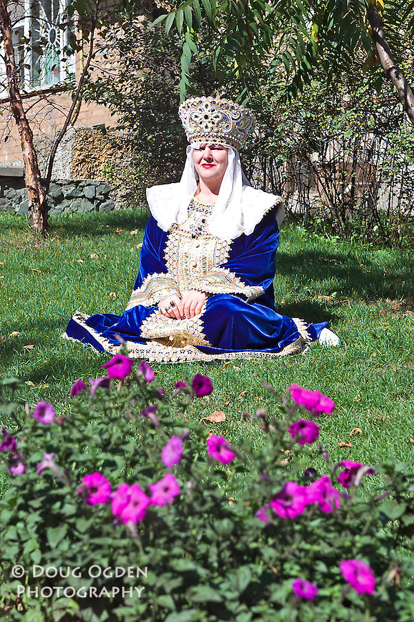 Woman in beautiful traditional dress and head piece or crown.  Each dress represents a different region of Russia, Vladivostok, Russia,