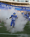 Dale Trimble runs onto the field at Commonwealth Stadium in Lexington, Ky on Sept. 18, 2010. Photo by Latara Appleby | Staff