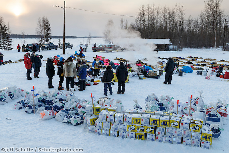 Musher food bags await the arrival of more mushers as the top 10 teams rest in Tanana in the early evening on March 10, 2015.   2015 Iditarod.<br /> <br /> (C) Jeff Schultz/SchultzPhoto.com - ALL RIGHTS RESERVED<br />  DUPLICATION  PROHIBITED  WITHOUT  PERMISSION