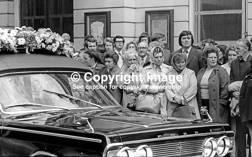 Funeral of N Ireland comedian James Young, 9th July 1974. Mourners watch as the hearse passes along Bedford Street where the entertainer  enjoyed such spectacular success in the Group Theatre. 197407090382b<br />