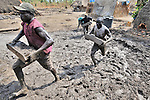 Men form mud into blocks that will be fired into bricks outside Minyori, a small village in Central Equatoria State in Southern Sudan. NOTE: In July 2011, Southern Sudan became the independent country of South Sudan
