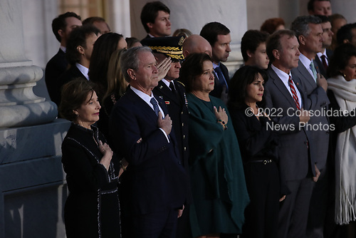 WASHINGTON, DC - DECEMBER 03: Former First Lady Laura Bush and Former President George W. Bush place their hands over their hearts as the casket of former U.S. President George H.W. Bush arrives at the U.S Capitol on December 03, 2018 in Washington, DC. A state funeral for former U.S. President Bush will be held in Washington over the next three days, beginning with him lying in state in the Rotunda of the U.S. Capitol until Wednesday morning.  (Photo by Win McNamee - Pool/Getty Images)