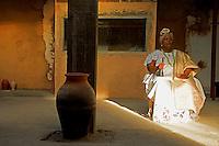 A local priestess in Brazil.