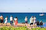 Tourists watch a Hawaiian Monk Seal on the beach at Ka'anapali, Maui. The Hawaiian monk seal, Monachus schauinslandi, is an endangered earless seal that is endemic to the waters off of the Hawaiian Islands