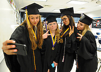 From left Dana Anne Tindall, Hailey Paige Tomino, Sasha Kaul Walbridge and Brianna Rose Thompson pose for a selfie before start of the 64th Commencement ceremony at Palisades High School Friday June 12, 2015 in Kintnersville, Pennsylvania.  (Photo by William Thomas Cain/Cain Images)
