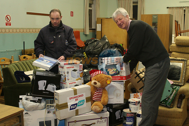 Robert Russell, Drogheda Borough Council and Dave Turner collecting items for the flood victims on Fair Street....Photo NEWSFILE/Jenny Matthews.(Photo credit should read Jenny Matthews/NEWSFILE)....This Picture has been sent you under the condtions enclosed by:.Newsfile Ltd..The Studio,.Millmount Abbey,.Drogheda,.Co Meath..Ireland..Tel: +353(0)41-9871240.Fax: +353(0)41-9871260.GSM: +353(0)86-2500958.email: pictures@newsfile.ie.www.newsfile.ie.FTP: 193.120.102.198.