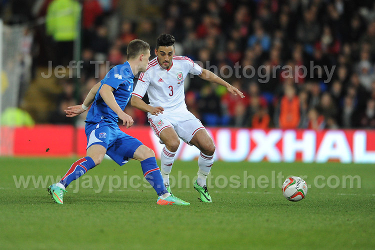 Johann Berg Guomundsson of Iceland challenges Neil Taylor of Wales. Cardiff City Stadium, Cardiff, Wales, Wednesday 5th March 2014. The Football Association of Wales - Vauxhall International Friendly - Wales v Iceland. Pictures by Jeff Thomas Photography - www.jaypics.photoshelter.com - Contact: thomastwotimes@live.co.uk - 07837 386244