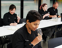 NWA Democrat-Gazette/CHARLIE KAIJO Jyothi Konda of Bentonville tests a wine's aroma during a wine tasting class, Monday, November 5, 2018 at Brightwater in Bentonville.<br /><br />Students tested sweet, savory and spicy flavors with a rosŽ, sauvignon blanc and chardaneŽ.<br /><br />&quot;Alcohol is a huge part of the culinary experience. If you go to a restaurant, the majority of the time there is going to be a beverage to pair with the food,&quot; said beverage arts director James King. &quot;When you do a lovely dish, you have to be on your game to know what&Otilde;s the dominant flavor of that dish to work out what&Otilde;s going to be the dominant flavor of the wine to do that pairing.&quot;