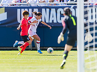 CHICAGO, IL - OCTOBER 6: Carli Lloyd #10 of the United States tries to dribble past a defender during a game between Korea Republic and USWNT at Soldier Field on October 6, 2019 in Chicago, Illinois.