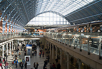 The interior of St. Pancras station, with Eurostar trains on the upper level in London, England, UK.