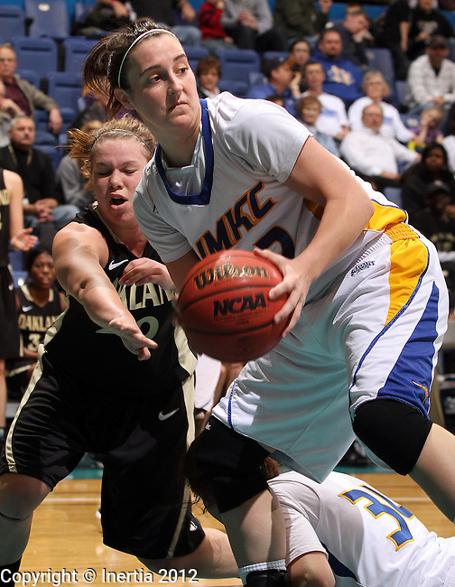SIOUX FALLS, SD - MARCH 4:  Brianna Eldridge #22 from UMKC keeps the ball from the reach of Peyton Apsey #20 from Oakland University in the second half of their game Sunday afternoon during the 2012 Summit League Tournament at the Sioux Falls Arena. (Photo by Dave Eggen/Inertia)