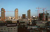 London:  1.  Panorama from St. Paul's --British Telegraph Center, near left; Barbican Towers, background; Going up?--Terry Farrell's London Wall project.  Photo Jan. '90.