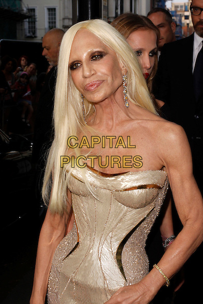 Donatella Versace.Arrivals at the Glamour Women Of The Year Awards, Berkeley Square Gardens, London, England..May 29th, 2012.half length gold strapless corset dress .CAP/AH.©Adam Houghton/Capital Pictures.