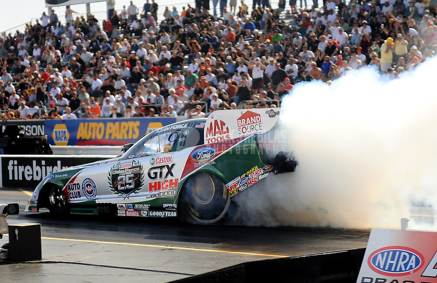 Feb. 19, 2010; Chandler, AZ, USA; NHRA funny car driver John Force during qualifying for the Arizona Nationals at Firebird International Raceway. Mandatory Credit: Mark J. Rebilas-