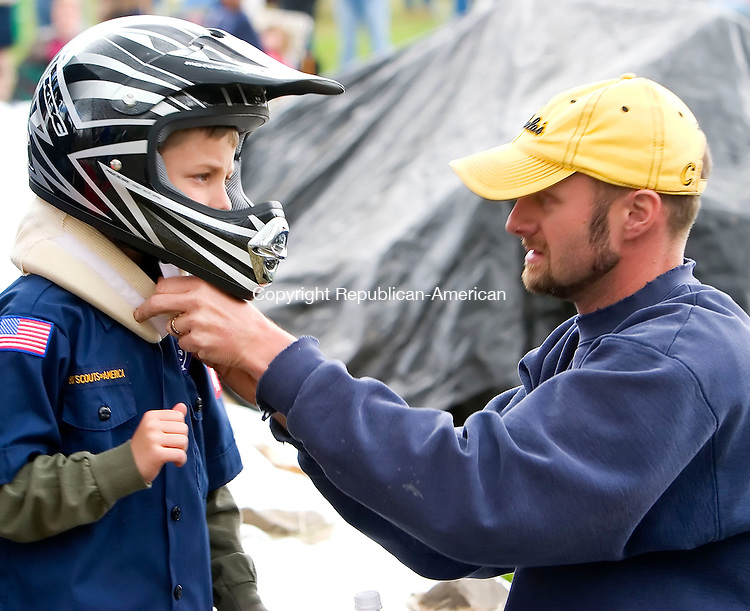 BETHLEHEM, CT- 29 APRIL 07- 042907JT07-<br /> Lee Steiner, right, fits his son Riley, 8, with a neck brace before he races in the 2nd annual Cub Scout Pack 459 Downhill Derby on Hard Hill Road North in Bethlehem on Sunday.<br /> Josalee Thrift Republican-American
