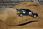 Driver Ramana Lagemann and co-driver Mike Fennell get some air while competing in the Rally Car Race finals during X-Games 12 in Los Angeles, California on August 5, 2006.