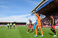 Swindon Town's Lawrence Vigouroux goes through a pre-match routine as he walks out onto the pitch<br /> <br /> Photographer Chris Vaughan/CameraSport<br /> <br /> The EFL Sky Bet League Two - Lincoln City v Swindon Town - Saturday 11th August 2018 - Sincil Bank - Lincoln<br /> <br /> World Copyright &copy; 2018 CameraSport. All rights reserved. 43 Linden Ave. Countesthorpe. Leicester. England. LE8 5PG - Tel: +44 (0) 116 277 4147 - admin@camerasport.com - www.camerasport.com
