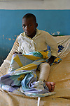 A boy healing from  a leg fracture in the surgery ward of Kibuye Hospital, Karongi District, Western Rwanda ..