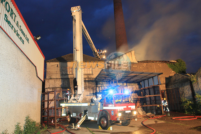 Drogheda Fire service were called to a fire at a disused timber production factory in Greenhills, Five fire appliances attended the fire..Picture Fran Caffrey/Newsfile.ie