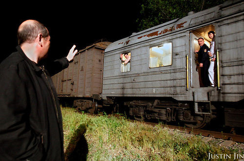 American-Ukrainian physicist Igor Bolshinsky waves goodbye to an armoured train carrying highly enriched uranium in Almaty, Kazakhstan, where the radioactive substance will be brought to Russia for downgrading. .The removal of Kazakhstan's highly enriched uranium (HEU) is part of the U.S. Global Threat Reduction Initiative (GTRI), where Igor Bolshinsky and Kelly Cummins work, that tries to secure nuclear material around the world to prevent their misuse by terrorists and rogue states.